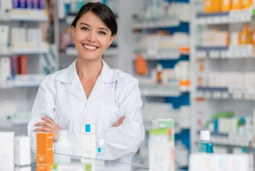 pharmacy assistant in front of wall